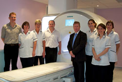 Staff at Royal Bournemouth Hospital, part of the Royal Bournemouth and Christchurch Hospitals NHS Foundation Trust welcome the arrival of a MAGNETOM® Aera 1.5 Tesla MRI system from Siemens Healthcare. (Left to right): Dr Mark Bryant, Radiology Fellow; Sarah Jenkins, Senior Radiographer; Susan Grundy, Senior Radiographer; Matthew Benbow, Superintendent Radiographer; Paul Vaughan, Regional Sales Manager at Siemens Healthcare; Samantha Tuomi, Senior Radiographer; Wendy Eden, Senior Radiographer; and Andrea Foden, Senior Radiographer.