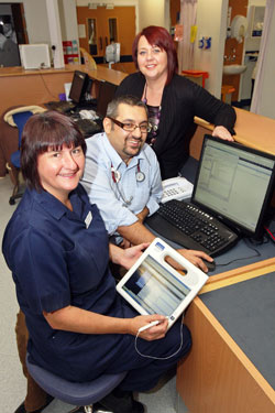Russells Hall Hospital, part of The Dudley Group NHS Foundation Trust, has transformed Emergency Department processes with paperless operation using Soarian® Clinicals from Siemens Healthcare. (From left to right: Lynn Thompson, Lead Nurse; Dr. Rajan Paw, Consultant Emergency Physician and Medical Head of Service; Belinda Williams, Administration Team Leader at Russells Hall Hospital.)