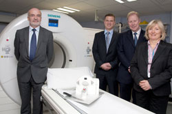 The official opening of one of the UK's first SOMATOM Definition Flash Dual Source CT scanners at Addenbrooke's Hospital, part of Cambridge University Hospitals NHS Foundation Trust in November 2009. Left to right: Gunter Dombrowe, Managing Director of the Siemens UK Healthcare Sector; Russell Lodge, CT Business Manager at Siemens Healthcare; Professor Adrian Dixon, Consultant Radiologist at Addenbrooke's Hospital and Liz Hunt, Associate Director of Operations for Cancer Services at Cambridge University Hospitals NHS Foundation Trust.