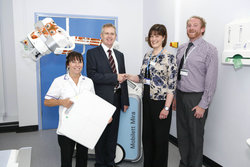 South Tyneside District Hospital, part of the South Tyneside NHS Foundation Trust has installed Siemens Healthcare's first mobile digital X-ray system with wireless detector from Siemens Healthcare. The installation is the first in the UK and is part of a wider order totalling three Mobilett Mira systems. [Left – right]: Alyson Baker, Assistant Practitioner for Radiography; Philip Tesh, Regional Sales Manager at Siemens Healthcare; Bronia Fleet, Clinical Business Manager, South Teesside NHS Foundation Trust; and Steve Philip, X-ray Application Specialist at Siemens Healthcare.