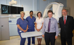 Kingston Hospital, part of Kingston Hospital NHS Trust, has recently installed an Artis zeeTM Multi-purpose (MP) interventional imaging system from Siemens Healthcare. (Left to right: Lucy Miller, Interventional Sister; Brent Sewlal, Radiology Staff Nurse; Amanda Kenevin, Superintendent Radiographer; Dr Michael Lynch, Lead Consultant Interventional Radiologist at Kingston Hospital and Malcolm Pickering, Regional Sales Manager at Siemens Healthcare.)