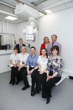 South Tyneside NHS Foundation Trust has ordered four Ysio wi-DTM systems from Siemens Healthcare, three of which have been installed and are being used in general digital radiography rooms. [Front left – right] Gillian Henderson, Radiographer Assistant; Barbara Bell, Lead Radiographer; Richard Cooper, Consultant Radiologist; Rebecca Shields, Radiographer and Bronia Fleet, Clinical Business Manager, South Tyneside NHS Foundation Trust. [Back left-right]: Philip Tesh, Regional Sales Manager at Siemens Healthcare; Joanne McAuliffe, UK Business Manager for X-Ray & Fluoroscopy Systems at Siemens Healthcare; and Steve Philip, X-ray Application Specialist at Siemens Healthcare.